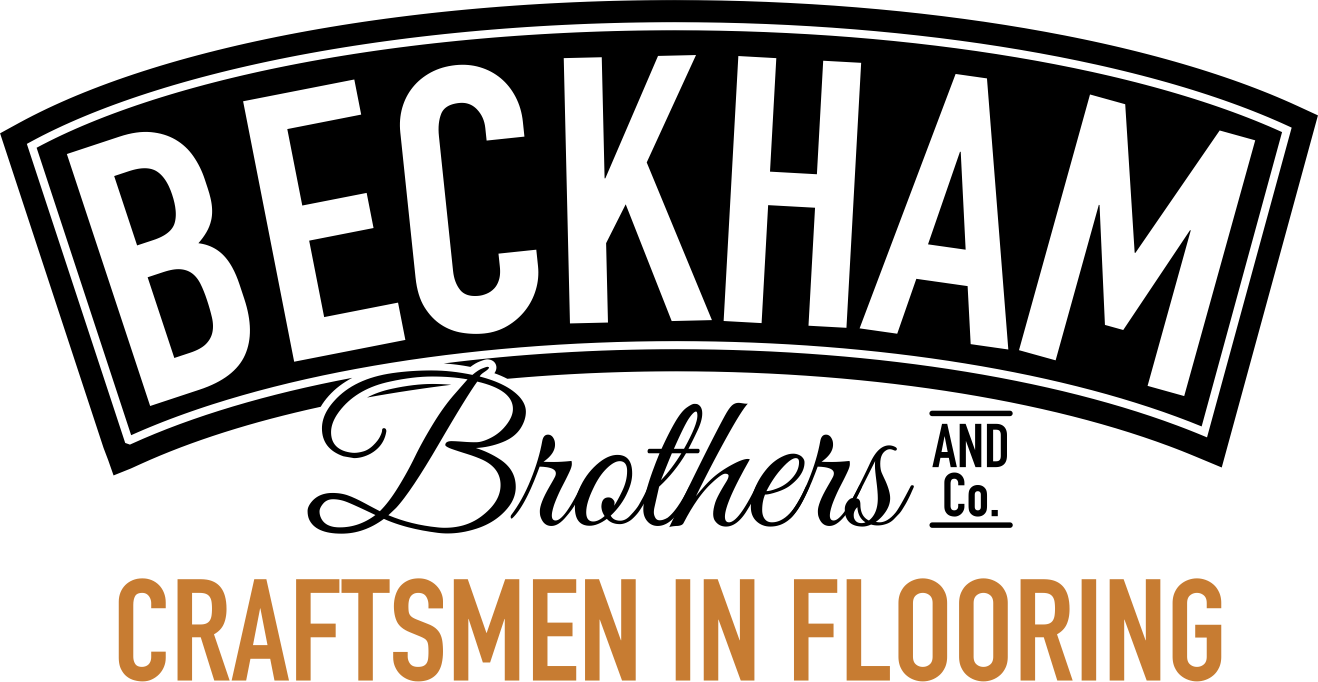 Beckham Brothers Flooring -shield-logo in black and orange