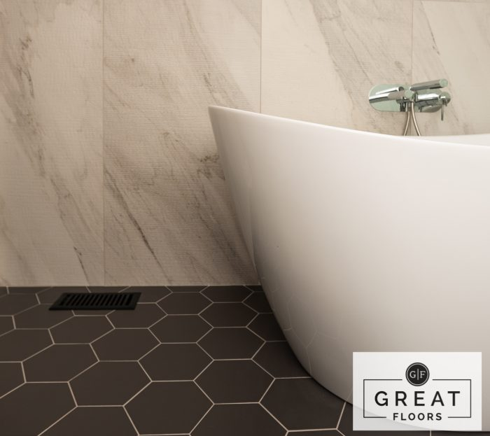 "Bathroom: Ceragres Forma 8"" Hex Tile (Floors) and Apuano Rullato White Experience (Wall) - Project by Springer Flooring"